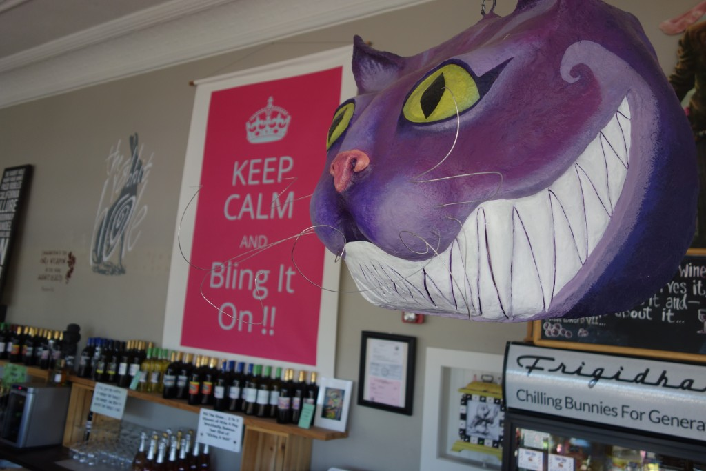 You don't have a disembodied Cheshire Cat head hanging at home?